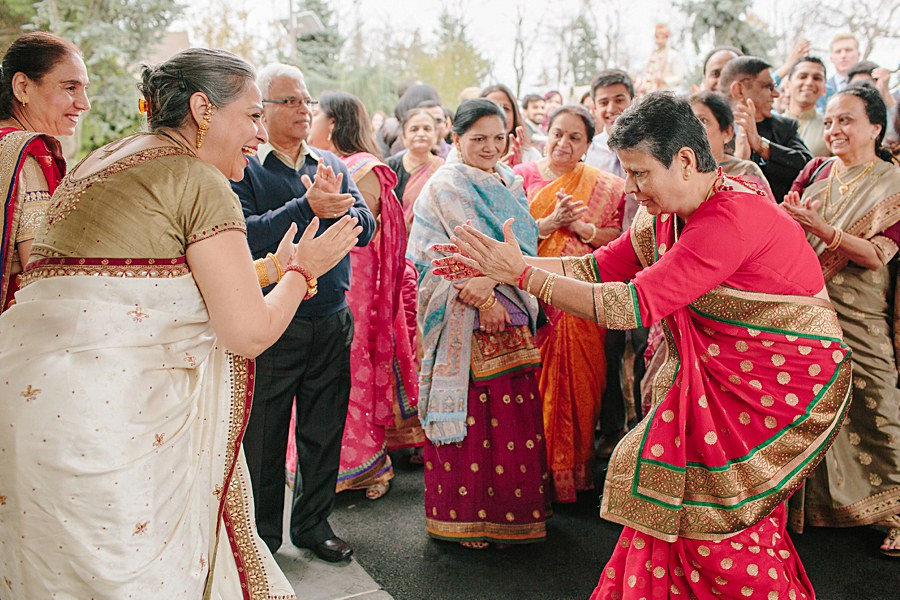 Mother of the Bride and Mother of the groom dancing during baraat